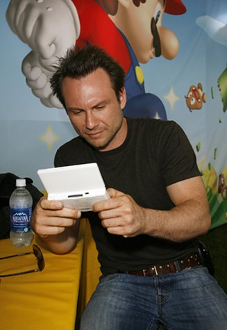 Christian Slater - one of those 'celebs' who was probably told to be seen with a DS...